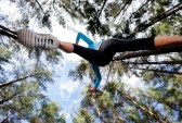 14342256-low-angle-view-of-runner-jumping-and-running-in-forest-healthy-active-lifestyle